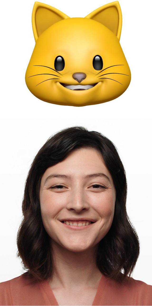 アニ文字のネコ画像の隣で素敵な笑顔を浮かべる女性の写真