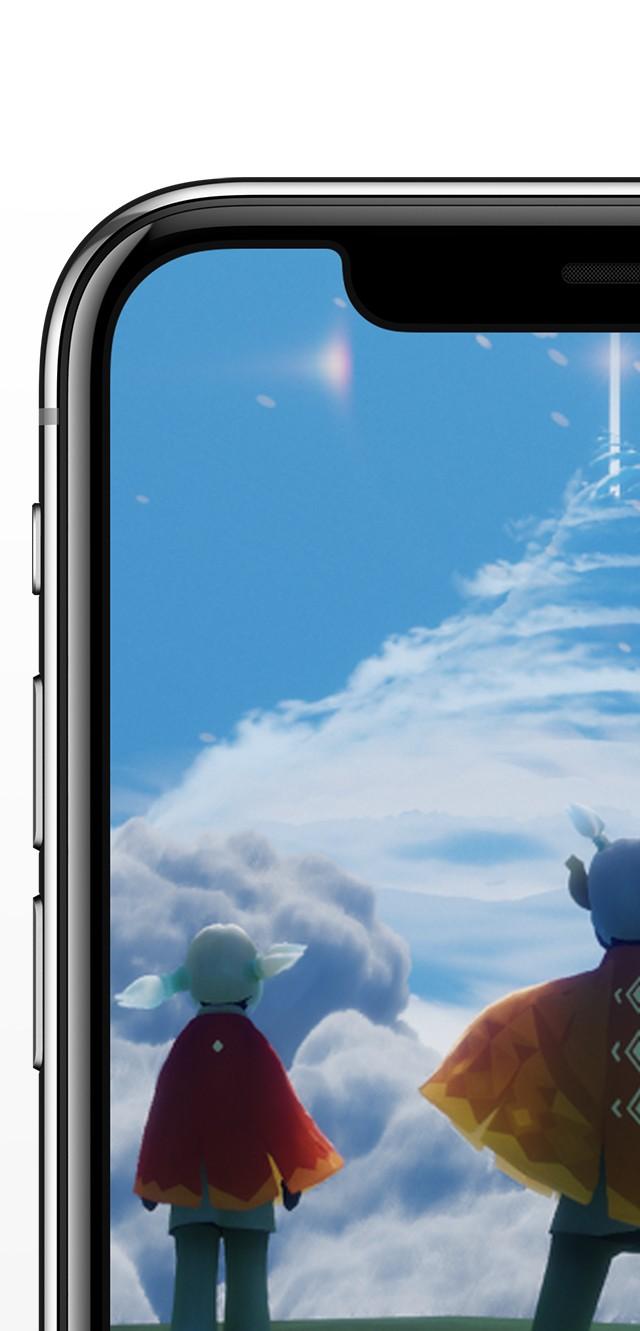 iPhone X シルバーの画面に2人のキャラクターが仮想現実で空を見上げているイラストが写っている画像