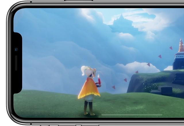 iPhone X シルバーの画面に1人のキャラクターがお城に向かって何か叫んでいるイラストが写っている画像